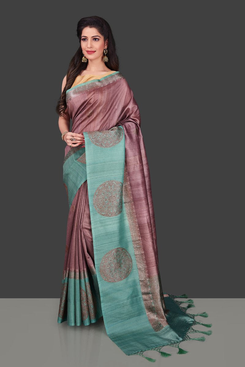 Buy beautiful mauve color tassar Benarasi saree online in USA with zari buta on green border. Shop beautiful Banarasi georgette sarees, tussar saris, pure muga silk saris in USA from Pure Elegance Indian fashion boutique in USA. Get spoiled for choices with a splendid variety of Indian sarees to choose from! Shop now.-full view