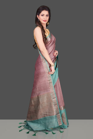 Buy beautiful mauve color tassar Benarasi saree online in USA with zari buta on green border. Shop beautiful Banarasi georgette sarees, tussar saris, pure muga silk saris in USA from Pure Elegance Indian fashion boutique in USA. Get spoiled for choices with a splendid variety of Indian sarees to choose from! Shop now.-side