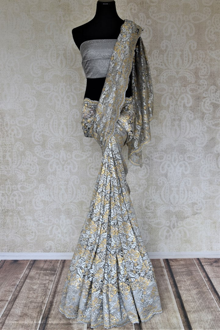 Shop beautiful grey and golden lace saree online in USA with stone work. Look beautiful on special occasions in lace sarees, embroidered sarees, designer saris from Pure Elegance Indian fashion boutique in USA. We bring a especially curated collection of ethnic sarees for Indian women in USA under one roof!-full view