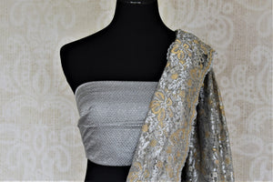 Shop beautiful grey and golden lace saree online in USA with stone work. Look beautiful on special occasions in lace sarees, embroidered sarees, designer saris from Pure Elegance Indian fashion boutique in USA. We bring a especially curated collection of ethnic sarees for Indian women in USA under one roof!-blouse