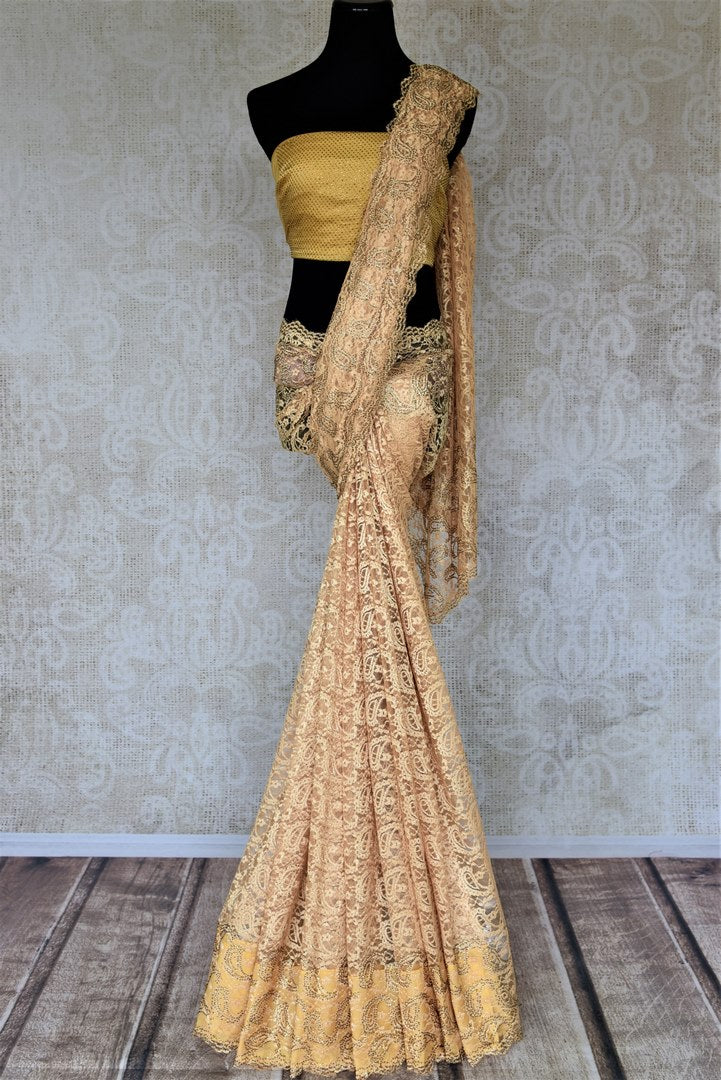 Buy elegant cream lace saree online in USA with stone work. Look beautiful on special occasions in lace sarees, embroidered sarees, designer saris from Pure Elegance Indian fashion boutique in USA. We bring a especially curated collection of ethnic sarees for Indian women in USA under one roof!-full view
