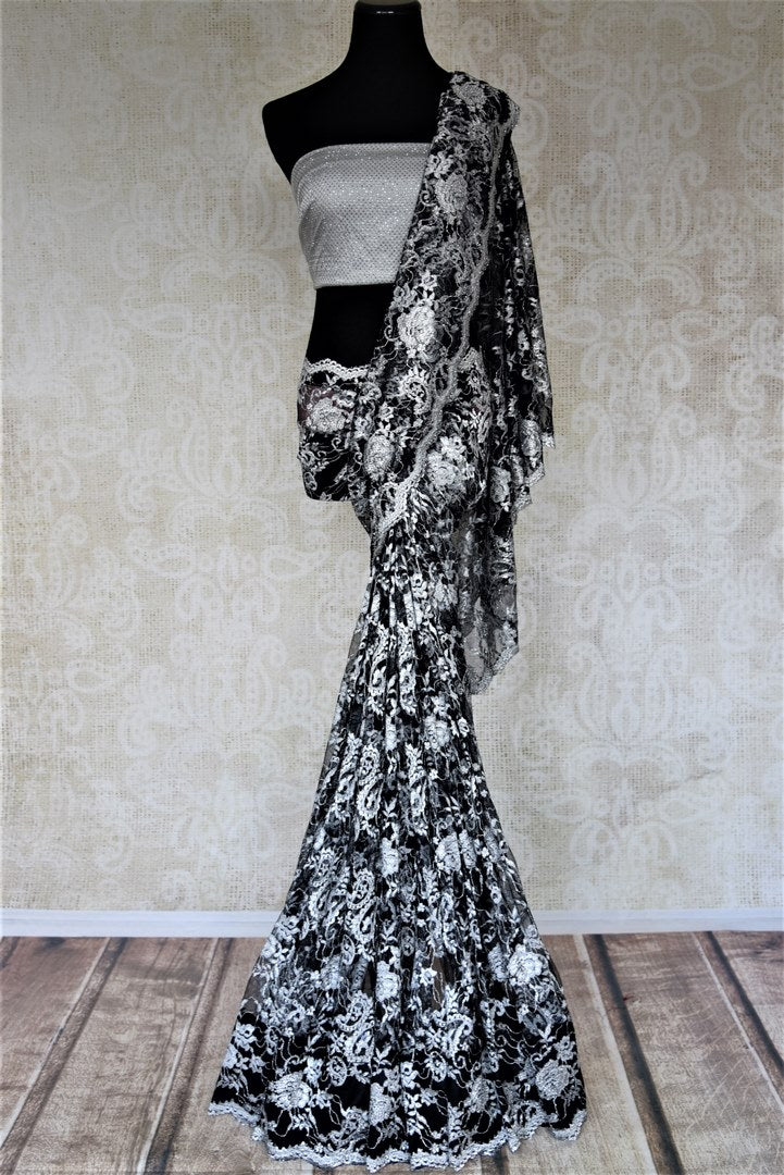 Shop beautiful black and grey designer lace saree online in USA with stone work. Look beautiful on special occasions in lace sarees, embroidered sarees, designer saris from Pure Elegance Indian fashion boutique in USA. We bring a especially curated collection of ethnic sarees for Indian women in USA under one roof!-full view