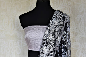 Buy gorgeous light grey stone work designer lace sari online in USA. Be the center of attraction at parties and weddings with beautiful designer sarees, embroidered sarees, handwoven sarees, Banarasi saris from Pure Elegance Indian fashion store in USA.-blouse pallu