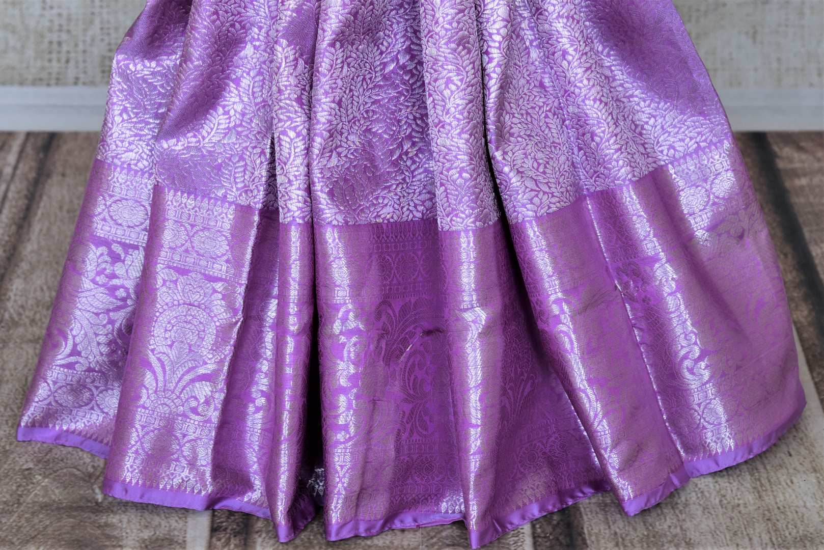 Shop stunning lavender silver zari work Kanjivaram sari online in USA. Look elegant at parties and special occasions in handwoven silk sarees, designer sarees with blouse, embroidered saris from Pure Elegance Indian luxury clothing store in USA.-pleats