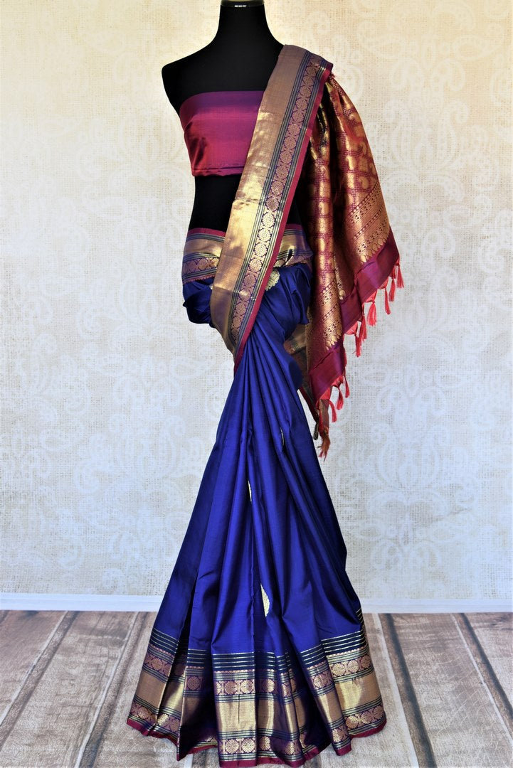 Shop beautiful dark blue Kanjivaram saree online in USA with golden zari border. For Indian women in USA, Pure Elegance Indian fashion store brings an exquisite collection Kanjeevaram sarees, Kanchipuram silk saris, tussar sarees, zari work sarees, pure silk sarees all under one roof. Shop online now.-full view