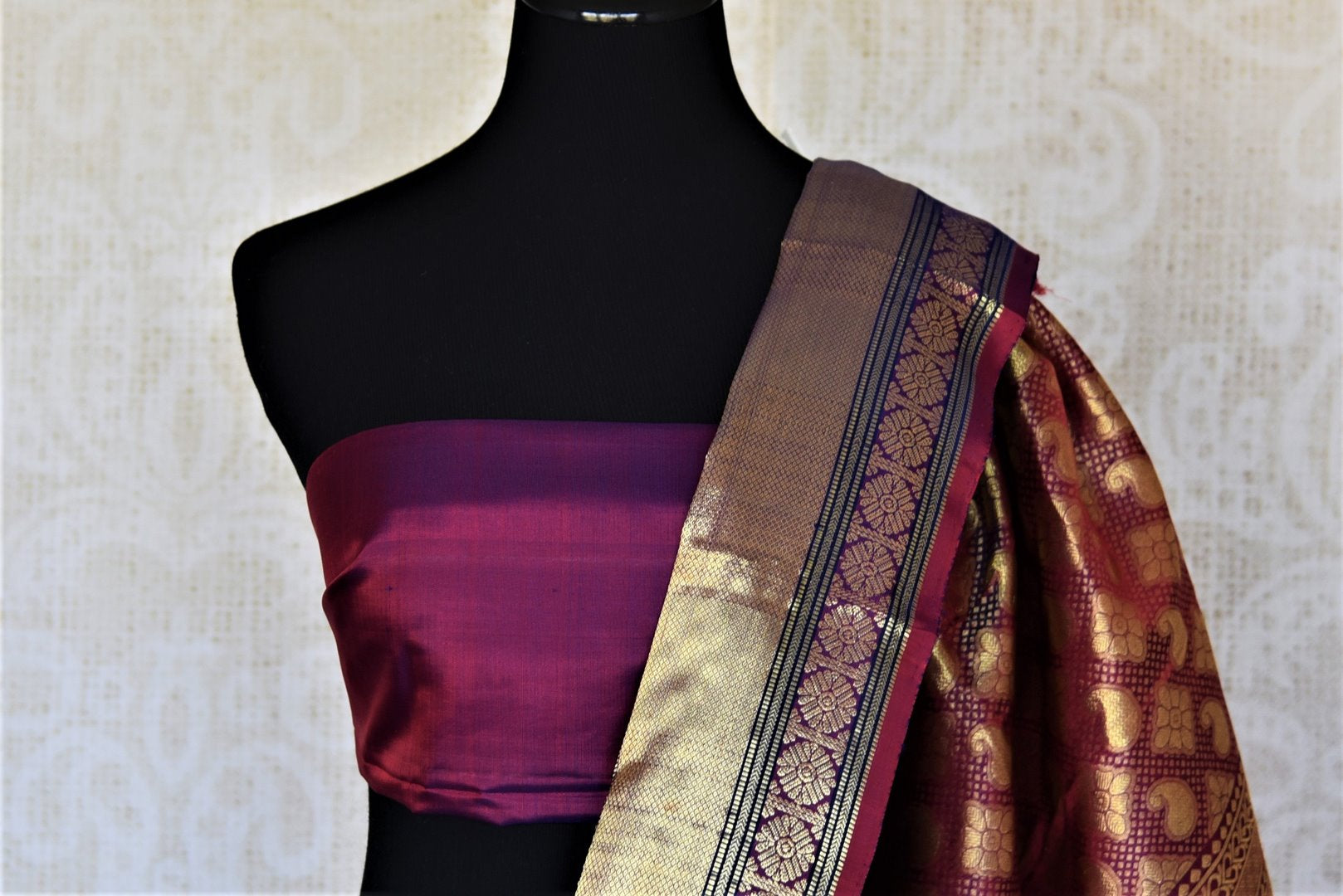Shop beautiful dark blue Kanjivaram saree online in USA with golden zari border. For Indian women in USA, Pure Elegance Indian fashion store brings an exquisite collection Kanjeevaram sarees, Kanchipuram silk saris, tussar sarees, zari work sarees, pure silk sarees all under one roof. Shop online now.-blouse pallu