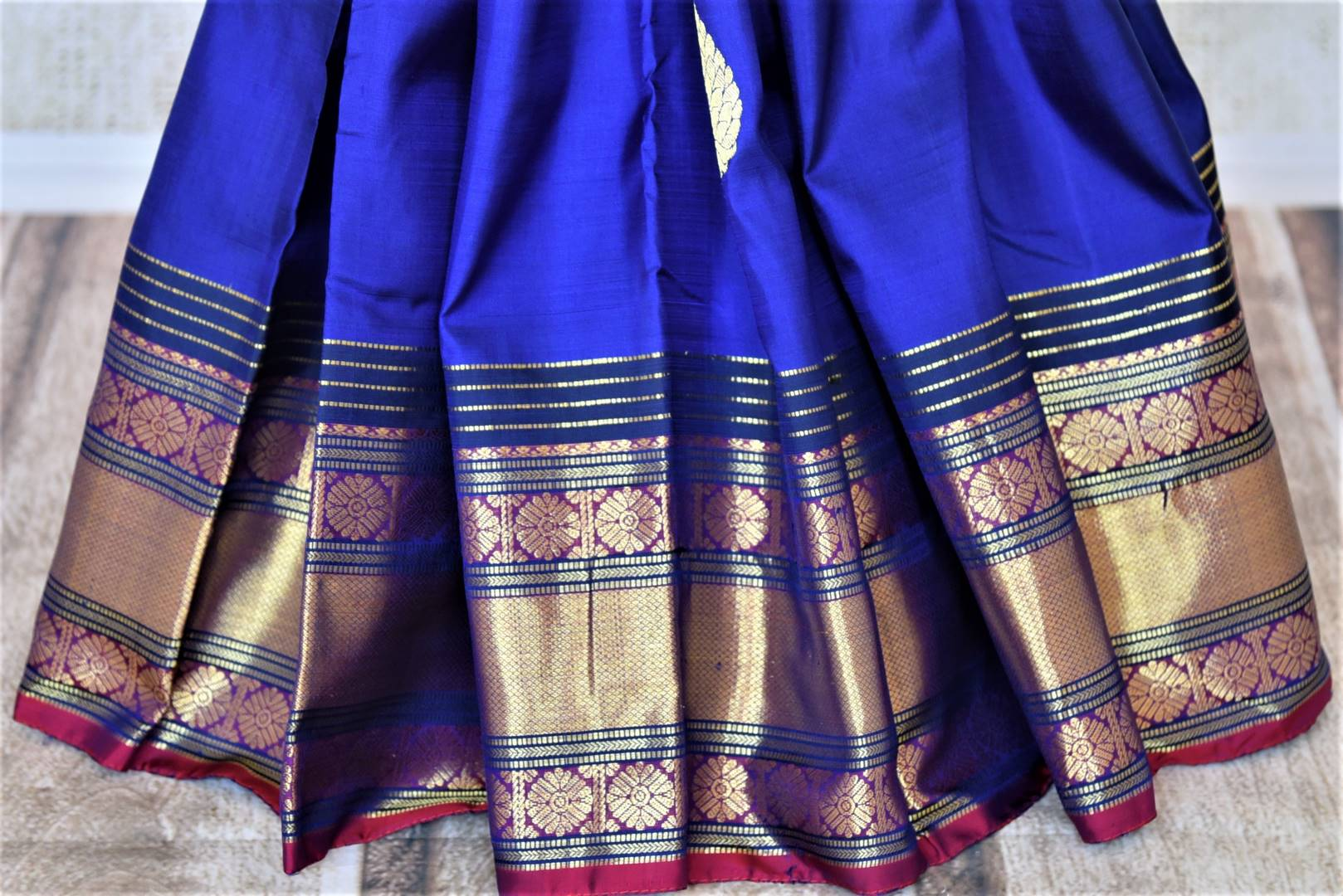 Shop beautiful dark blue Kanjivaram saree online in USA with golden zari border. For Indian women in USA, Pure Elegance Indian fashion store brings an exquisite collection Kanjeevaram sarees, Kanchipuram silk saris, tussar sarees, zari work sarees, pure silk sarees all under one roof. Shop online now.-pleats