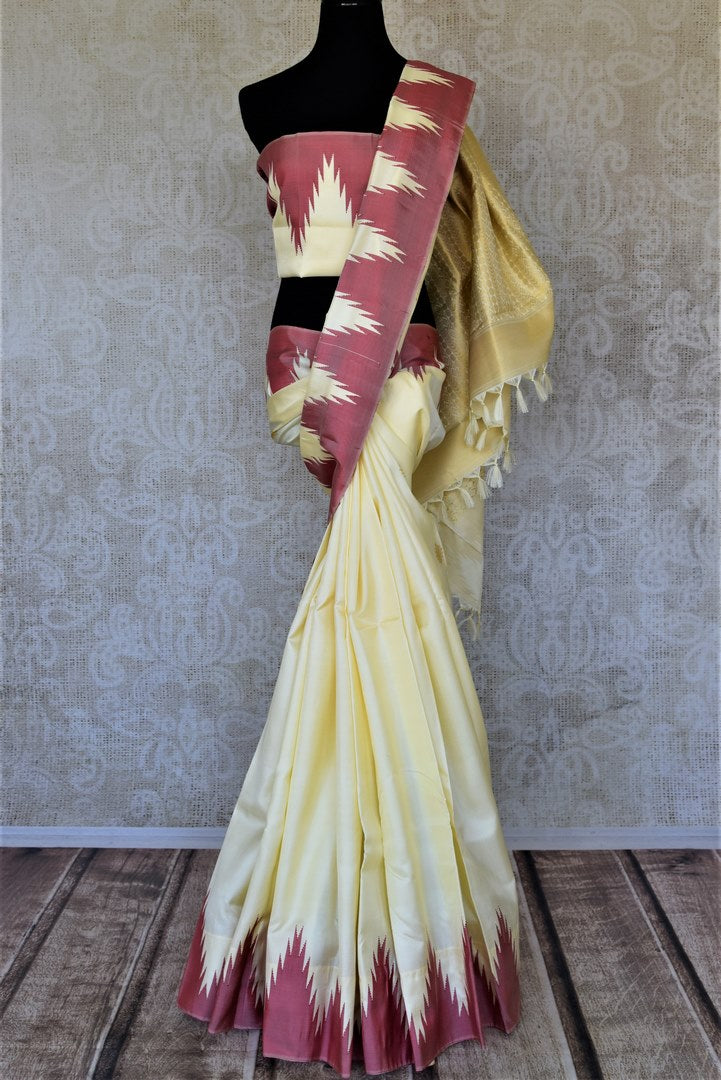 Buy lovely cream Kanjeevaram silk saree online in USA with pink temple border. Choose from a splendid variety of soft silk sarees, Kanjivaram silk sarees for weddings and festive occasions from Pure Elegance Indian clothing store in USA.-full view