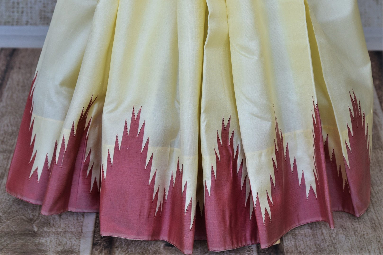 Buy lovely cream Kanjeevaram silk saree online in USA with pink temple border. Choose from a splendid variety of soft silk sarees, Kanjivaram silk sarees for weddings and festive occasions from Pure Elegance Indian clothing store in USA.-pleats
