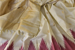 Buy lovely cream Kanjeevaram silk saree online in USA with pink temple border. Choose from a splendid variety of soft silk sarees, Kanjivaram silk sarees for weddings and festive occasions from Pure Elegance Indian clothing store in USA.-details