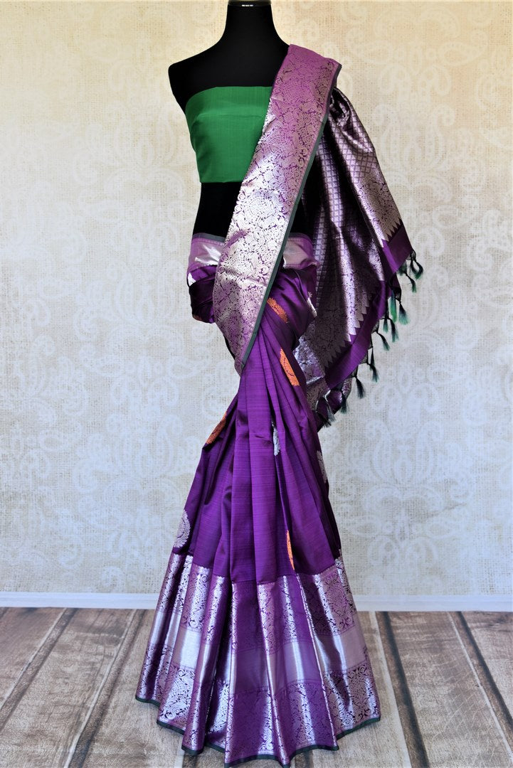 Buy beautiful purple Kanjivaram sari online in USA with heavy silver zari border. Look elegant at parties and special occasions in handwoven silk sarees, designer sarees with blouse, embroidered saris from Pure Elegance Indian luxury clothing store in USA.-full view