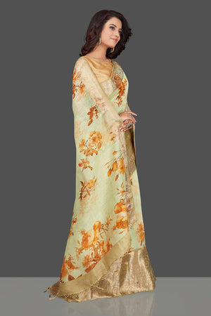 Buy elegant mint green floral linen Banarasi saree online in USA with zari border. Look charming on festivals and weddings with stunning Banarasi sarees from Pure Elegance Indian clothing store in USA. Your one stop destination for Indian fashion in USA!-side