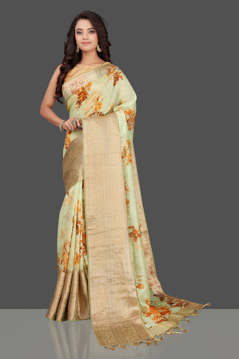 Buy elegant mint green floral linen Banarasi saree online in USA with zari border. Look charming on festivals and weddings with stunning Banarasi sarees from Pure Elegance Indian clothing store in USA. Your one stop destination for Indian fashion in USA!-full view
