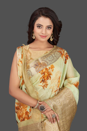 Buy elegant mint green floral linen Banarasi saree online in USA with zari border. Look charming on festivals and weddings with stunning Banarasi sarees from Pure Elegance Indian clothing store in USA. Your one stop destination for Indian fashion in USA!-closeup