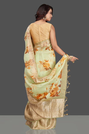 Buy elegant mint green floral linen Banarasi saree online in USA with zari border. Look charming on festivals and weddings with stunning Banarasi sarees from Pure Elegance Indian clothing store in USA. Your one stop destination for Indian fashion in USA!-back