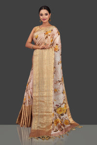 Shop stunning powder pink floral linen Banarasi sari online in USA with zari border. Look charming on festivals and weddings with stunning Banarasi sarees from Pure Elegance Indian clothing store in USA. Your one stop destination for Indian fashion in USA!-full view