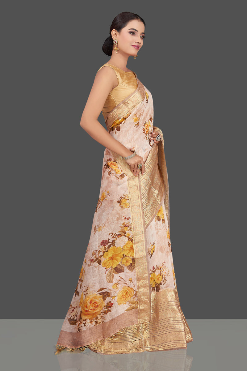 Shop stunning powder pink floral linen Banarasi sari online in USA with zari border. Look charming on festivals and weddings with stunning Banarasi sarees from Pure Elegance Indian clothing store in USA. Your one stop destination for Indian fashion in USA!-right