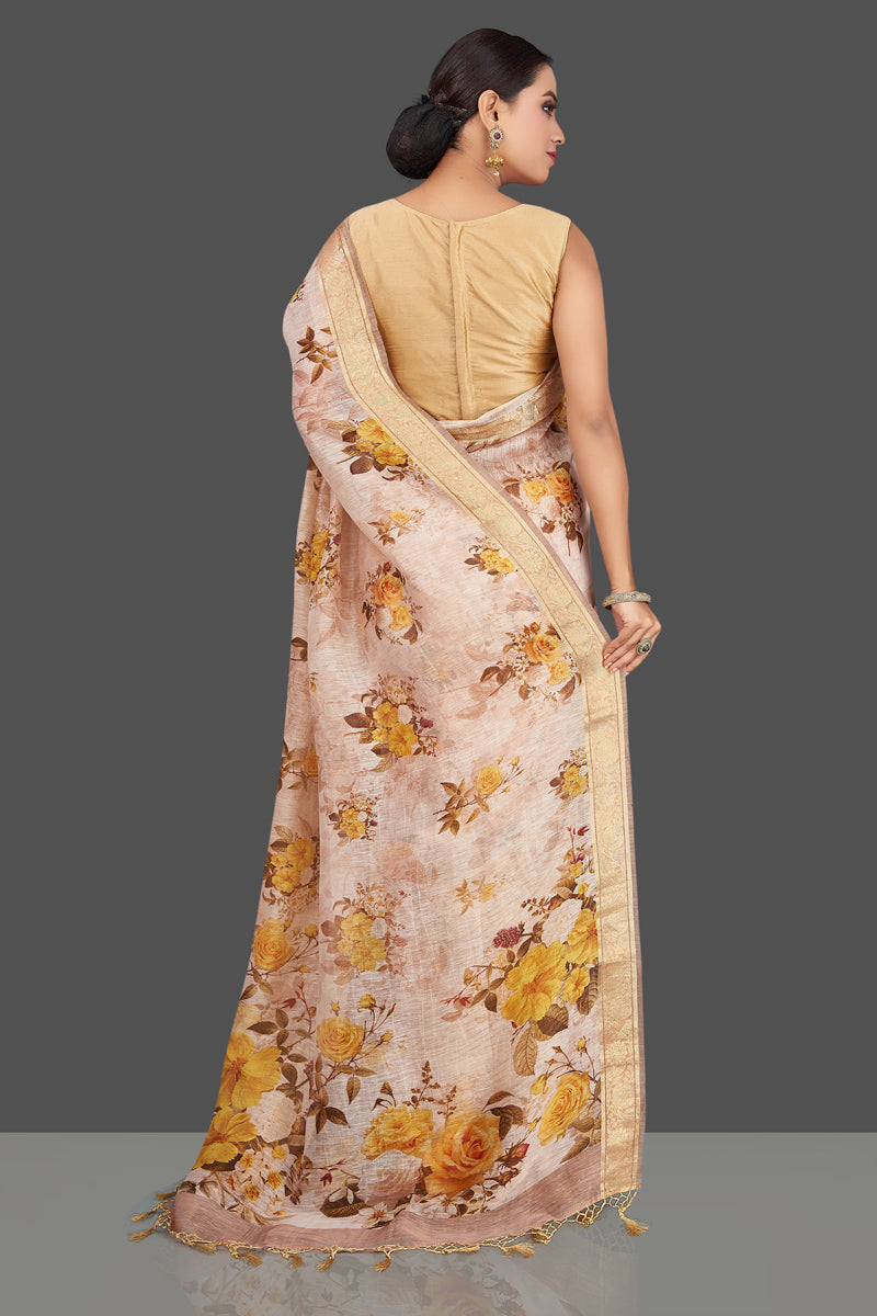 Shop stunning powder pink floral linen Banarasi sari online in USA with zari border. Look charming on festivals and weddings with stunning Banarasi sarees from Pure Elegance Indian clothing store in USA. Your one stop destination for Indian fashion in USA!-back