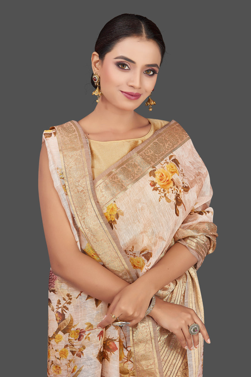 Shop stunning powder pink floral linen Banarasi sari online in USA with zari border. Look charming on festivals and weddings with stunning Banarasi sarees from Pure Elegance Indian clothing store in USA. Your one stop destination for Indian fashion in USA!-closeup