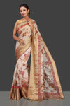 Buy lovely powder pink floral Banarasi linen saree online in USA with golden zari border. Look charming on festivals and weddings with stunning Banarasi sarees from Pure Elegance Indian clothing store. Your one stop destination for Indian fashion in USA!-full view