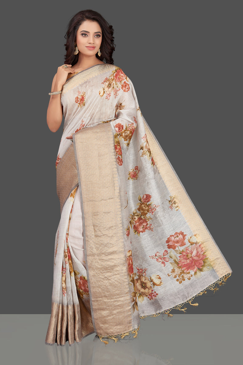 Shop gorgeous light grey floral Banarasi linen sari online in USA with golden zari border. Look charming on festivals and weddings with stunning Banarasi sarees from Pure Elegance Indian clothing store. Your one stop destination for Indian fashion in USA!-full view