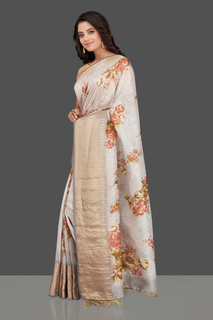Shop gorgeous light grey floral Banarasi linen sari online in USA with golden zari border. Look charming on festivals and weddings with stunning Banarasi sarees from Pure Elegance Indian clothing store. Your one stop destination for Indian fashion in USA!-left