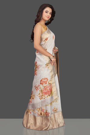 Shop gorgeous light grey floral Banarasi linen sari online in USA with golden zari border. Look charming on festivals and weddings with stunning Banarasi sarees from Pure Elegance Indian clothing store. Your one stop destination for Indian fashion in USA!-right