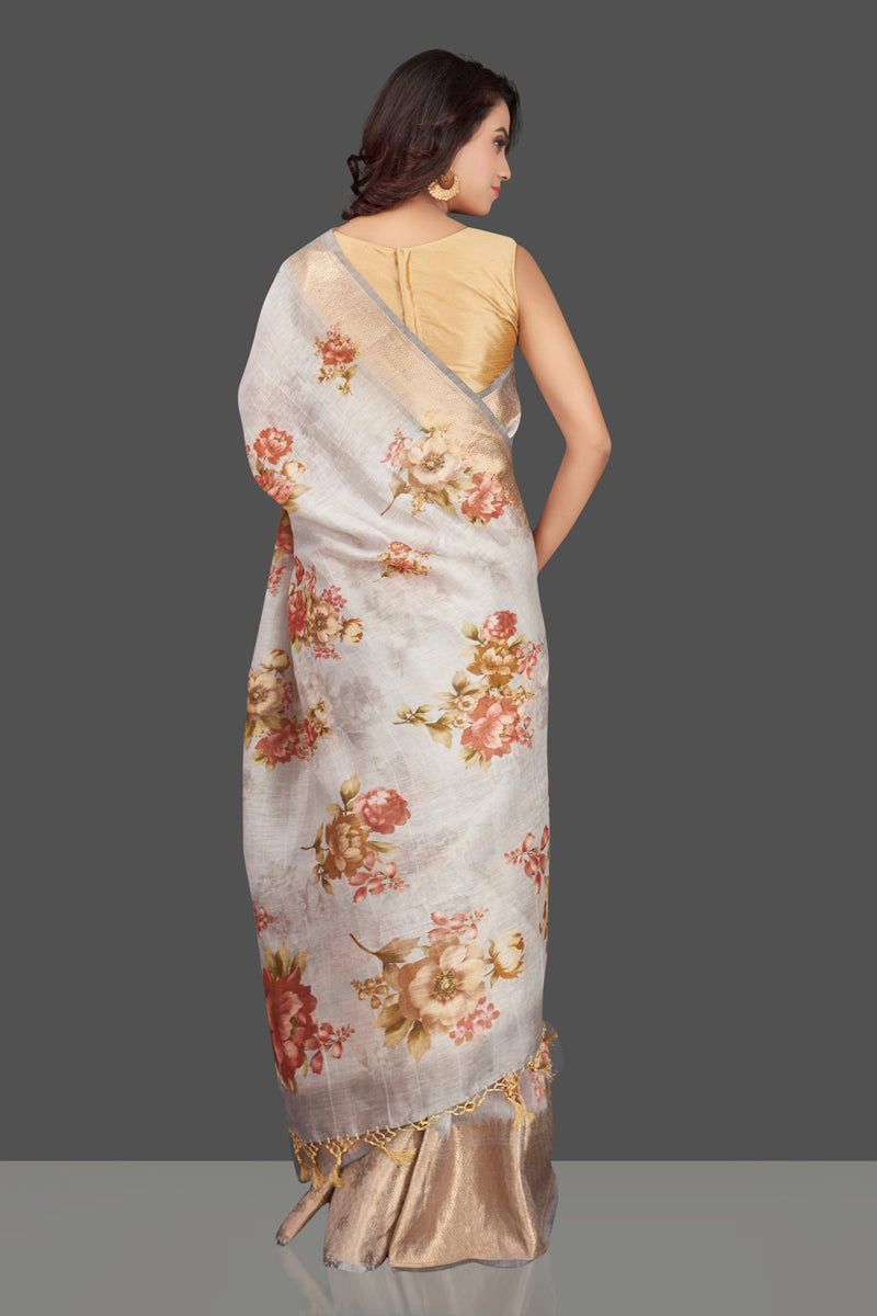 Shop gorgeous light grey floral Banarasi linen sari online in USA with golden zari border. Look charming on festivals and weddings with stunning Banarasi sarees from Pure Elegance Indian clothing store. Your one stop destination for Indian fashion in USA!-back