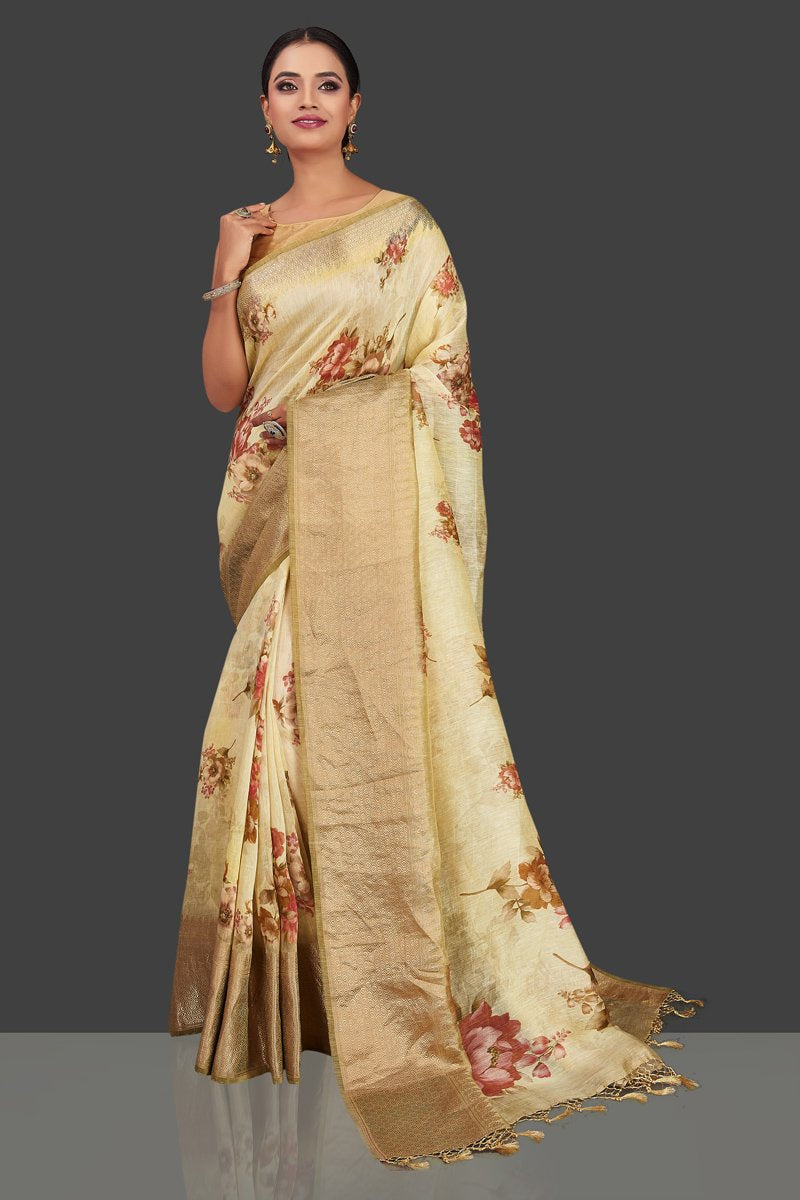 Shop beautiful cream floral Banarasi linen saree online in USA with golden zari border. Look charming on festivals and weddings with stunning Banarasi sarees from Pure Elegance Indian clothing store. Your one stop destination for Indian fashion in USA!-full view