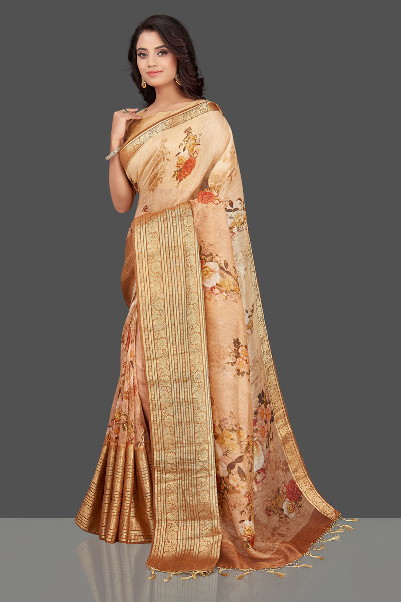 Shop beautiful ombre peach floral Banarasi linen saree online in USA with golden zari border. Look charming on festivals and weddings with stunning Banarasi sarees from Pure Elegance Indian clothing store. Your one stop destination for Indian fashion in USA!-front