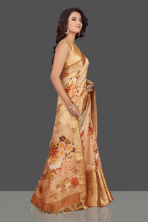 Shop beautiful ombre peach floral Banarasi linen saree online in USA with golden zari border. Look charming on festivals and weddings with stunning Banarasi sarees from Pure Elegance Indian clothing store. Your one stop destination for Indian fashion in USA!-side