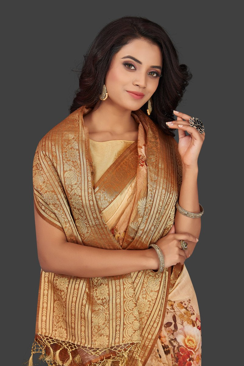 Shop beautiful ombre peach floral Banarasi linen saree online in USA with golden zari border. Look charming on festivals and weddings with stunning Banarasi sarees from Pure Elegance Indian clothing store. Your one stop destination for Indian fashion in USA!-closeup