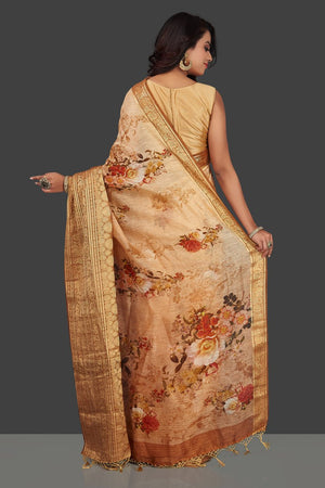 Shop beautiful ombre peach floral Banarasi linen saree online in USA with golden zari border. Look charming on festivals and weddings with stunning Banarasi sarees from Pure Elegance Indian clothing store. Your one stop destination for Indian fashion in USA!-back