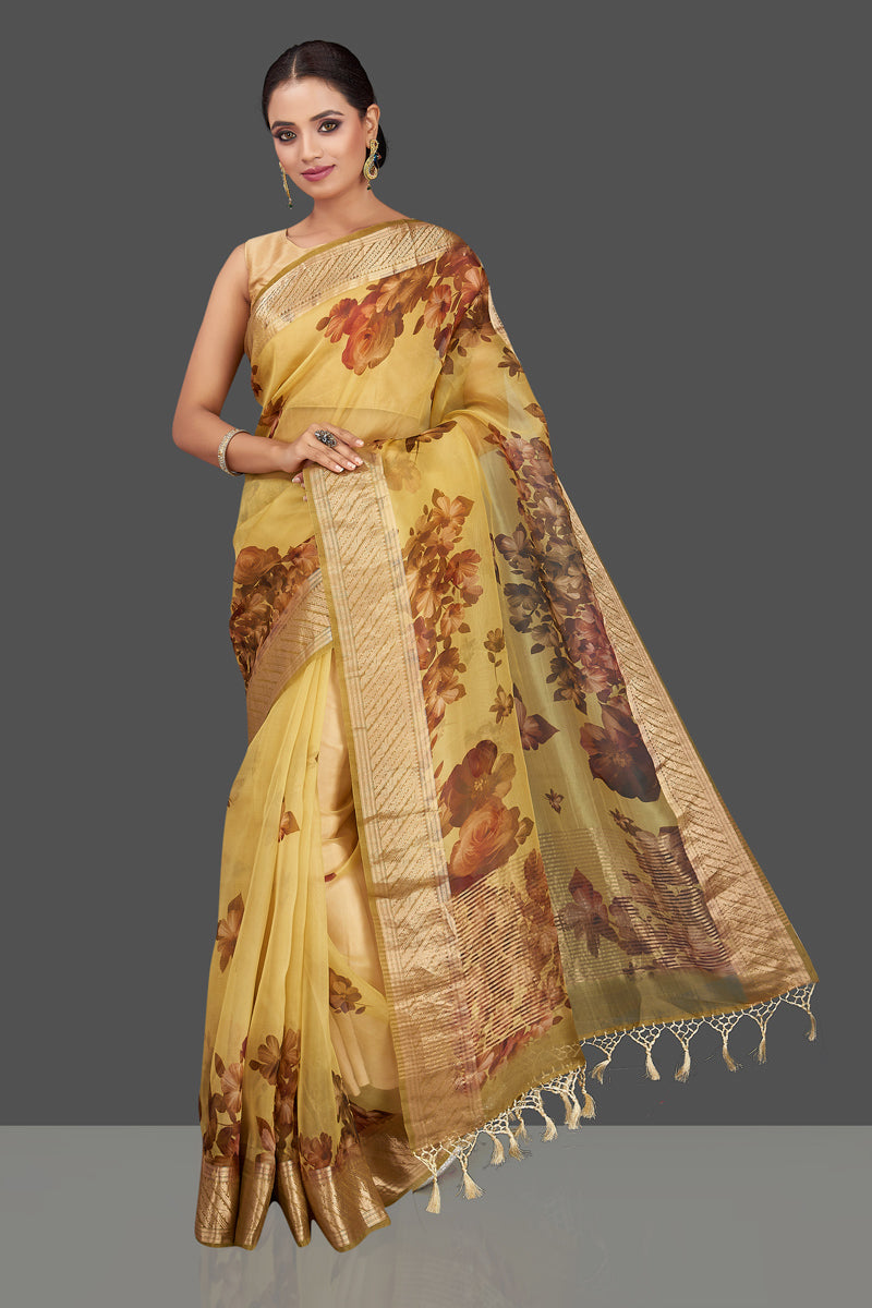 Shop yellow floral linen Benarasi saree online in USA with zari border. Radiate ethnic elan on festivals and weddings with stunning linen sarees, pure silk sarees, traditional Banarasi saris from Pure Elegance Indian fashion store in USA.-full view