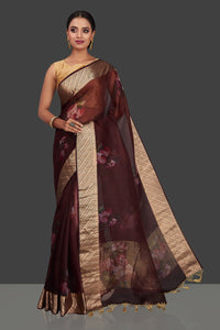 Shop rich wine color floral organza Banarasi saree online in USA with golden zari border. Look charming on festivals and weddings with stunning Banarasi sarees from Pure Elegance Indian clothing store. Your one stop destination for Indian fashion in USA!-full view