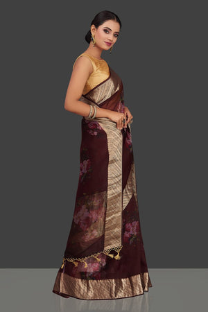 Shop rich wine color floral organza Banarasi saree online in USA with golden zari border. Look charming on festivals and weddings with stunning Banarasi sarees from Pure Elegance Indian clothing store. Your one stop destination for Indian fashion in USA!-left