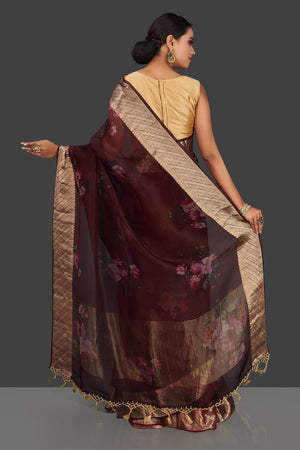 Shop rich wine color floral organza Banarasi saree online in USA with golden zari border. Look charming on festivals and weddings with stunning Banarasi sarees from Pure Elegance Indian clothing store. Your one stop destination for Indian fashion in USA!-back