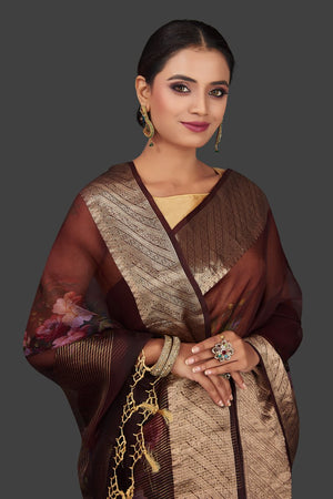 Shop rich wine color floral organza Banarasi saree online in USA with golden zari border. Look charming on festivals and weddings with stunning Banarasi sarees from Pure Elegance Indian clothing store. Your one stop destination for Indian fashion in USA!-closeup