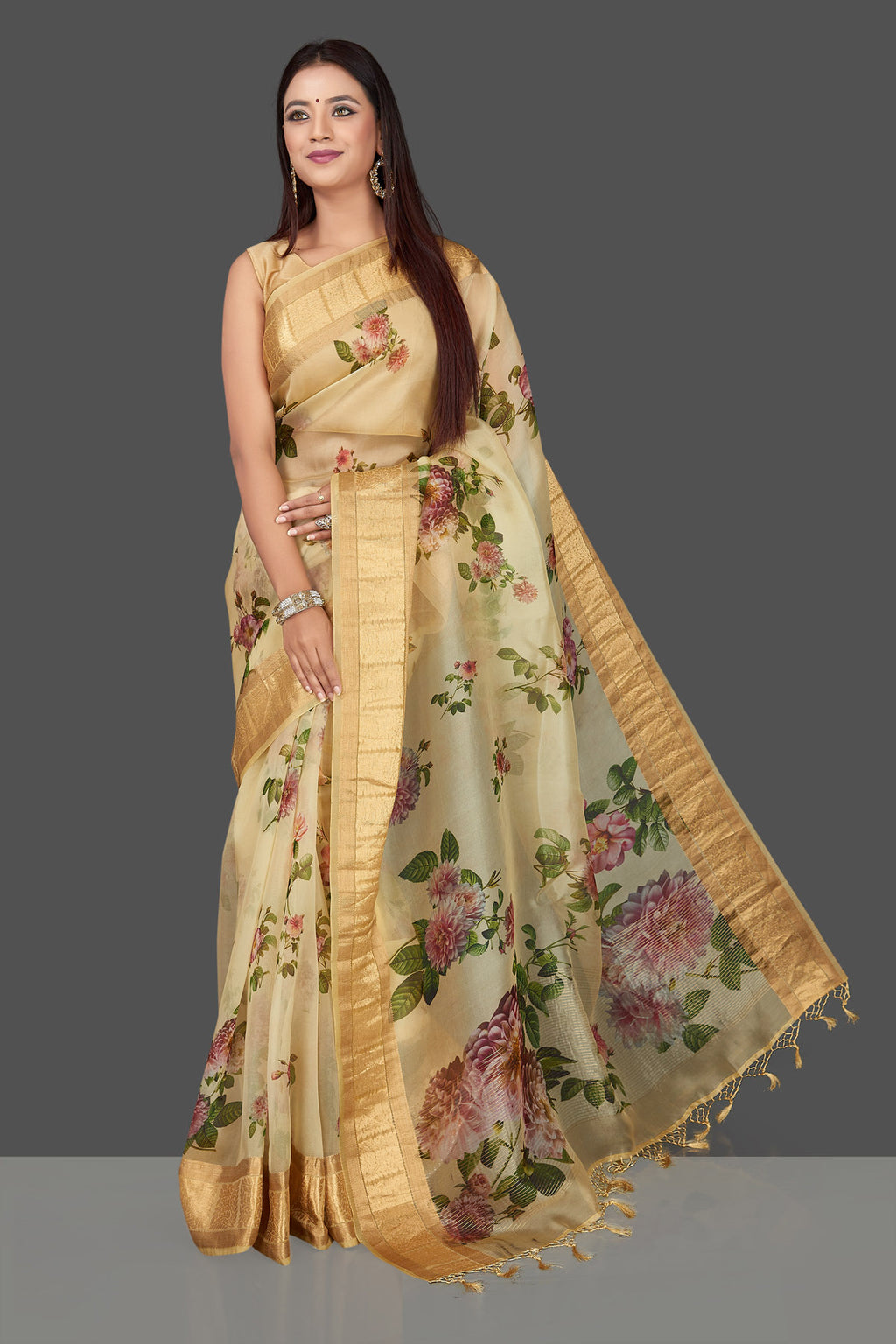Shop beautiful yellow organza Banarasi saree online in USA with floral print and zari border. Radiate ethnic elan on festivals and weddings with stunning muga sarees, pure silk sarees, traditional Banarasi sarees from Pure Elegance Indian fashion store in USA.-full view