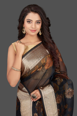 Buy navy blue floral organza Banarasi sari online in USA with zari border. Look charming on festivals and weddings with stunning Banarasi sarees from Pure Elegance Indian clothing store. Your one stop destination for Indian fashion in USA!-closeup