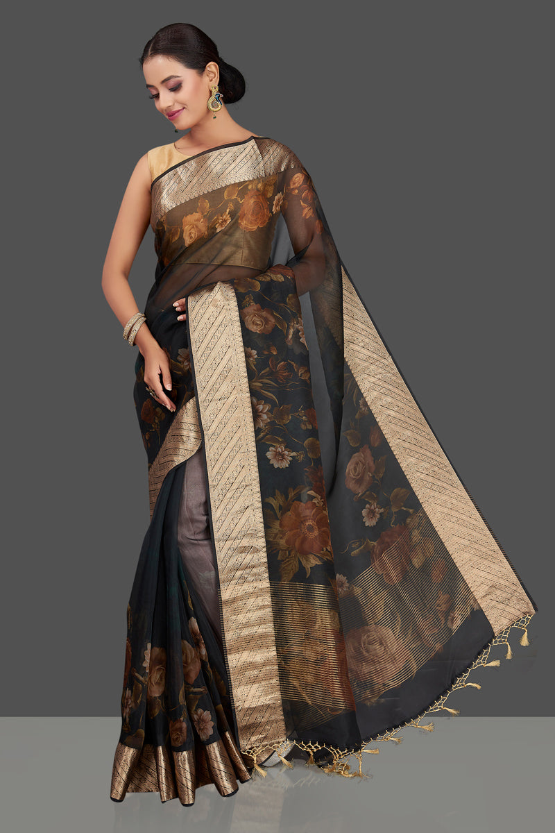 Buy attractive navy blue floral organza Banarasi saree online in USA with golden zari border. Look charming on festivals and weddings with stunning Banarasi sarees from Pure Elegance Indian clothing store. Your one stop destination for Indian fashion in USA-full view