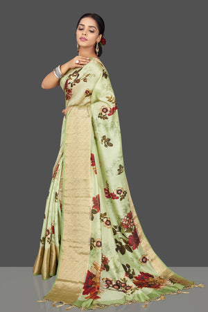 Buy charming mint green muga saree online in USA with zari border. Be the center of attraction at weddings and parties with your captivating ethnic style in beautiful pure silk sarees. handwoven sarees from Pure Elegance Indian fashion store in USA.-right side