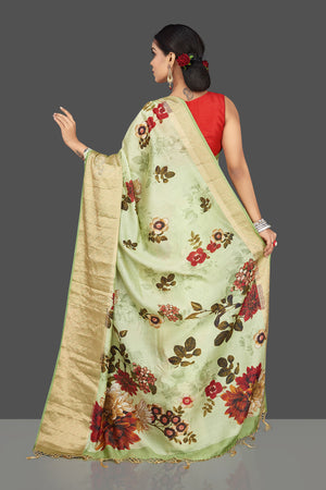 Buy charming mint green muga saree online in USA with zari border. Be the center of attraction at weddings and parties with your captivating ethnic style in beautiful pure silk sarees. handwoven sarees from Pure Elegance Indian fashion store in USA.-back