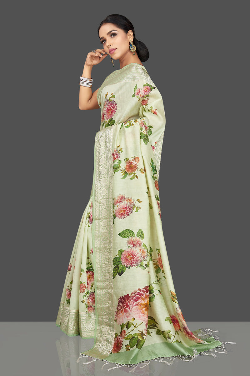 Buy beautiful mint green floral print muga saree online in USA with zari border. Be the center of attraction at weddings and parties with your captivating ethnic style in beautiful pure silk sarees. handwoven saris from Pure Elegance Indian fashion store in USA.-left side