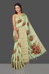 Shop stunning mint green floral print muga Banarasi saree online in USA with zari border. Radiate ethnic elan on festivals and weddings with stunning muga sarees, printed silk sarees, traditional Banarasi sarees from Pure Elegance Indian fashion store in USA.-full view