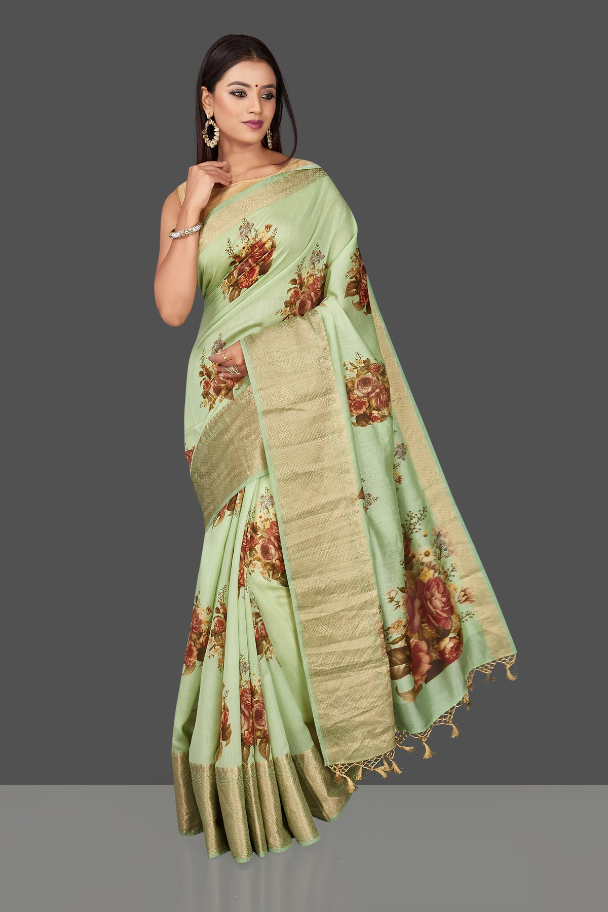 Shop stunning mint green floral print muga Banarasi saree online in USA with zari border. Radiate ethnic elan on festivals and weddings with stunning muga sarees, printed silk sarees, traditional Banarasi sarees from Pure Elegance Indian fashion store in USA.-front