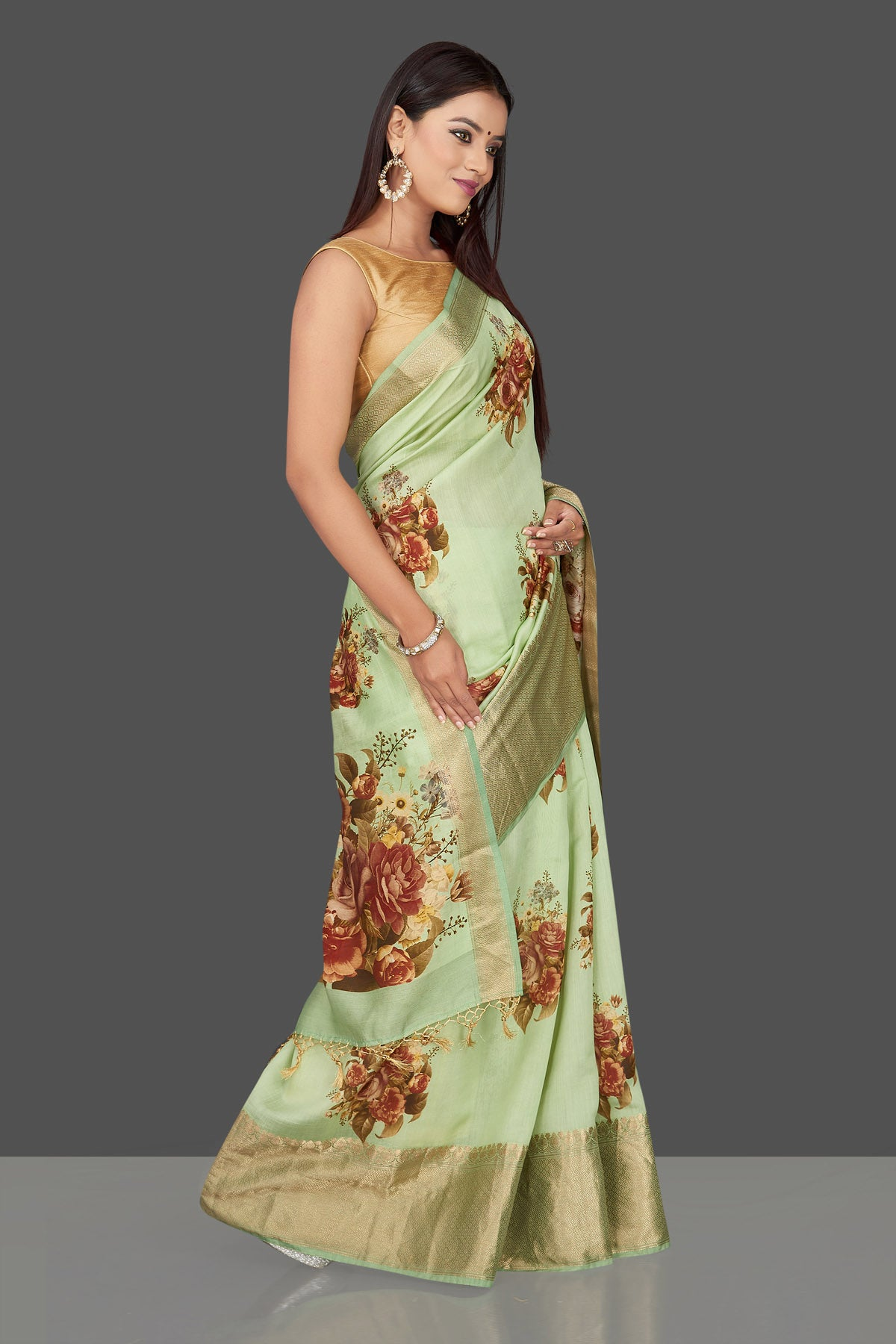 Shop stunning mint green floral print muga Banarasi saree online in USA with zari border. Radiate ethnic elan on festivals and weddings with stunning muga sarees, printed silk sarees, traditional Banarasi sarees from Pure Elegance Indian fashion store in USA.-right
