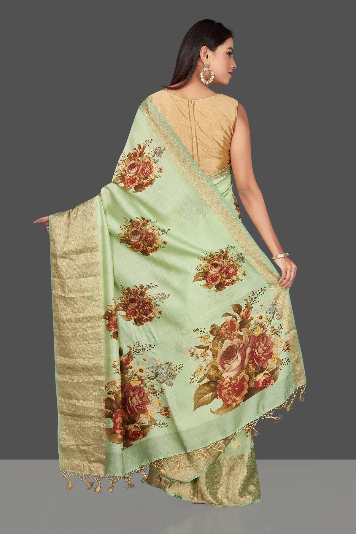 Shop stunning mint green floral print muga Banarasi saree online in USA with zari border. Radiate ethnic elan on festivals and weddings with stunning muga sarees, printed silk sarees, traditional Banarasi sarees from Pure Elegance Indian fashion store in USA.-back