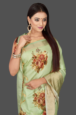 Shop stunning mint green floral print muga Banarasi saree online in USA with zari border. Radiate ethnic elan on festivals and weddings with stunning muga sarees, printed silk sarees, traditional Banarasi sarees from Pure Elegance Indian fashion store in USA.-closeup
