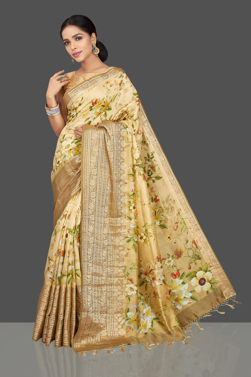 Shop graceful cream yellow floral muga saree online in USA with zari border. Be the center of attraction at weddings and parties with your captivating ethnic style in beautiful pure silk sarees. floral sarees from Pure Elegance Indian fashion store in USA.-full view